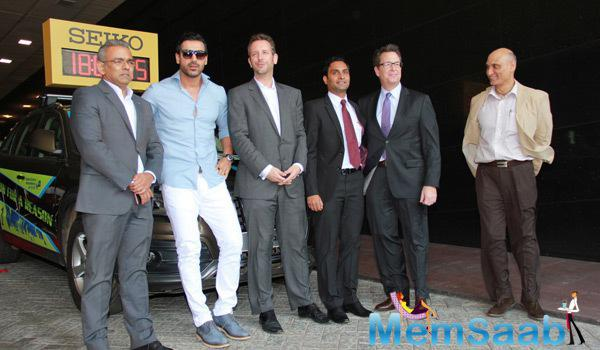 John Abraham Gave A Pose With The Team Of SCMM Group For The Shutterbugs