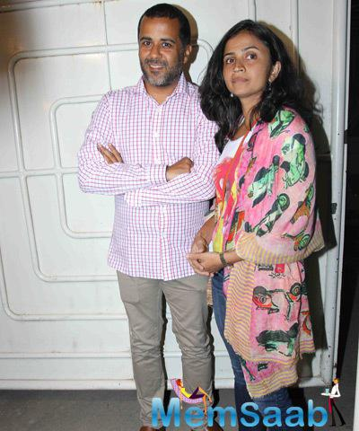 Writer Chetan Bhagat With Wife Anusha Bhagat Posed During The Special Screening Of Tevar Movie
