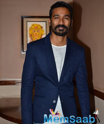 Dhanush Posing For The Photos During The Promotion Of Shamitabh