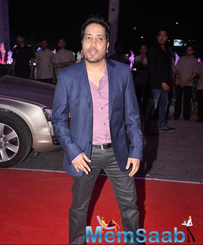 Mika Singh Strikes A Pose At Kush Sinha Wedding Reception