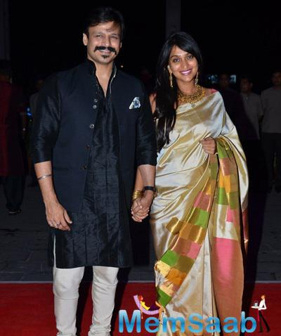 Vivek Oberoi With Wife Priyanka Alva Oberoi Smiling Pose At Kush Sinha Wedding Reception