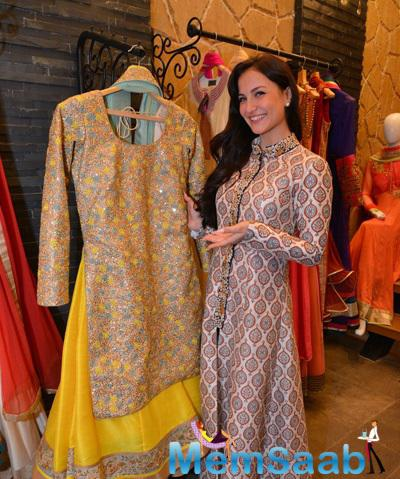 Elli Avram Posing With A Designer Suit During The Store Launch