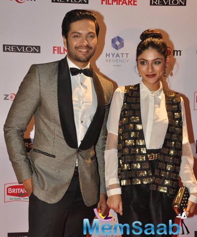 Ali Fazal And Sapna Pabbi Smiling Pose At 60th Britannia Filmfare Pre-Awards Night Bash