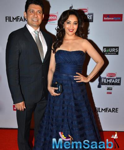 Sriram Madhav Nene And His Gorgeous Wife Madhuri Dixit Smiling Pose At 60th Britannia Filmfare Awards 2015