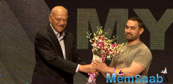 Aamir Presented With A Bouquet Of Flowers At The Event By Mr. Rubero