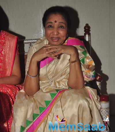 Asha Pose During The Dr.Veena Mundhra's Shri Hari Vani Gita Album And Book Launch Event
