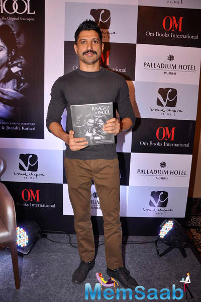 Farhan Akhtar Posing With The Book At The Launch