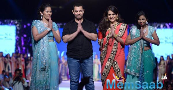 Aamir Khan And Shaina NC Greets The Audience On Ramp During 10th Annual Caring With Style Fashion Show