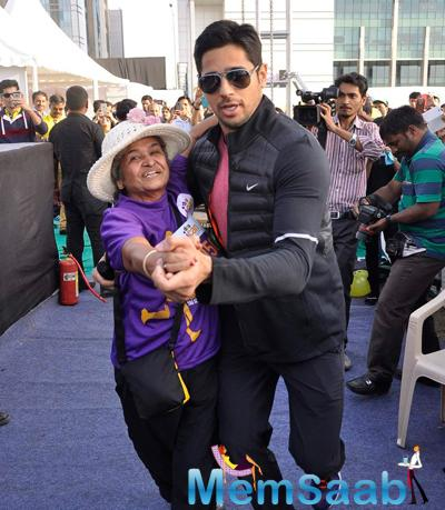 Sidharth Malhotra Shakes A Leg With A Fan At DNA Race