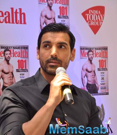 John Abraham Addresses The Media During The Cover Launch Of Men's Health Magazine 101 Issue
