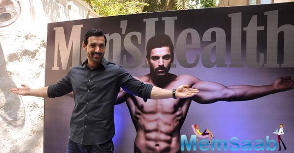 John Abraham Cool Pose During The Cover Launch Of Men's Health Magazine 101 Issue