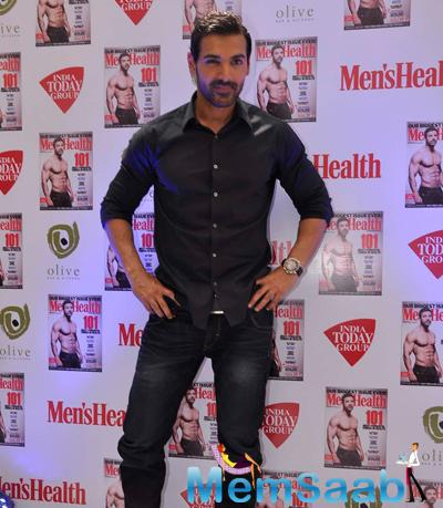 John Abraham Posed For Camera During The Launch Of Men's Health Magazine Cover Page