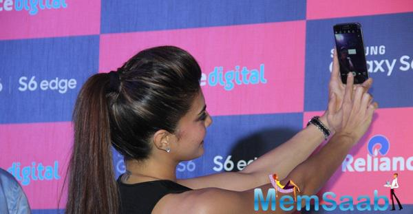 Jacqueline Fernandez Taking Selfies With The New Smartphone