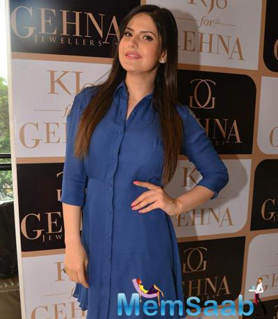 Zarine Khan Strikes A Pose During The Launch Of Karan Johar Limited Edition Holiday Line For Gehna Jewellers