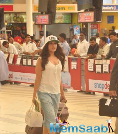 Richa Snapped At Airport With Jerry Pinto's  Helen Book And Candy Bag