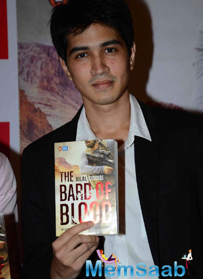 Bilal Siddiqi Shows His Book During His Book Launch Event