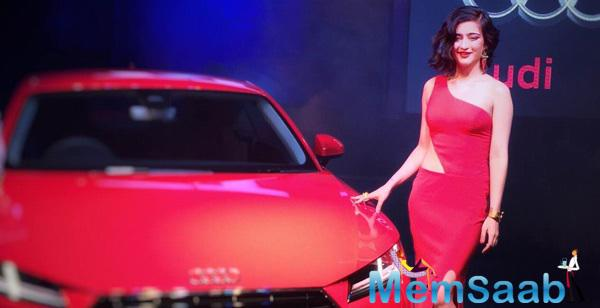 Akshara Attended The Launch Of Audi TT In Chennai Giving Us A Red Look In A Sonaakshi Raaj Gown