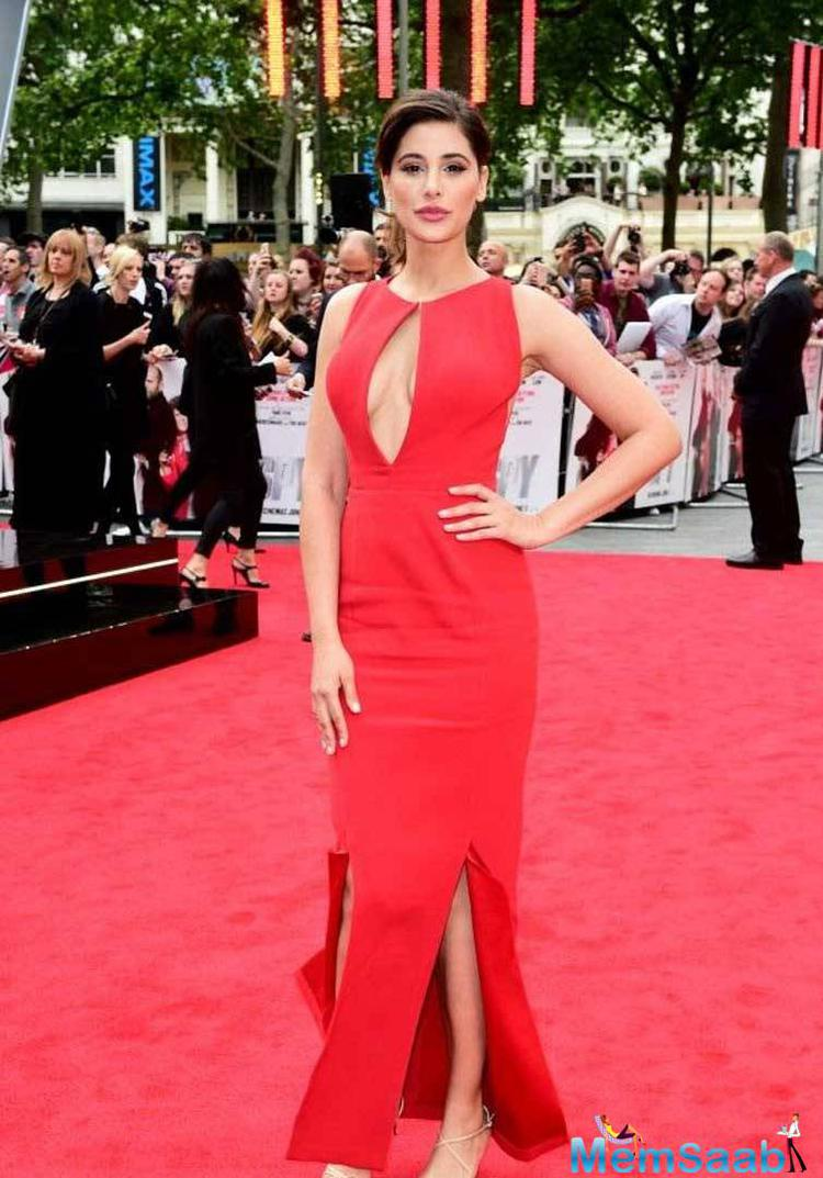 Nargis Fakhri Makes Heads Turn In Red At 'Spy's London Premiere