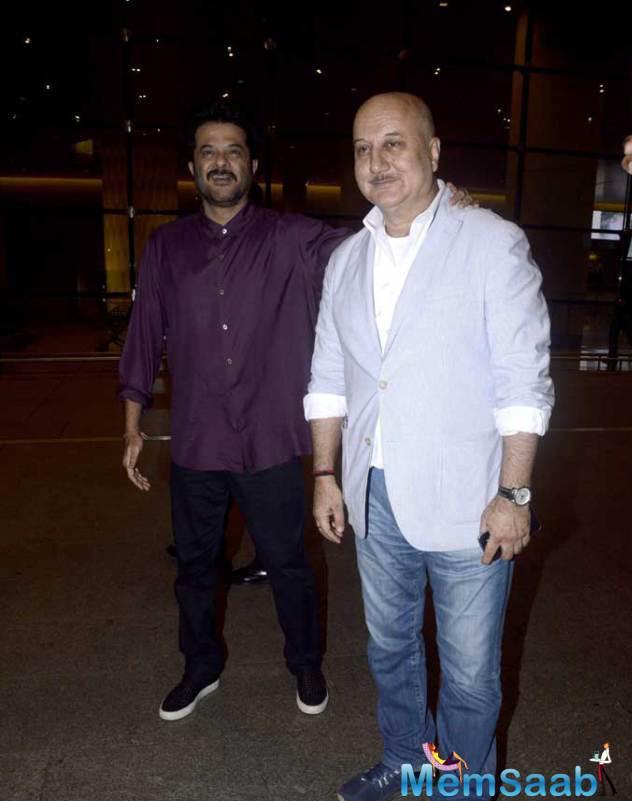 Anil And Anupam Pose Together At Mumbai Airport