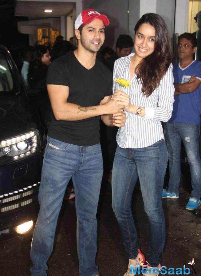Shraddha And Varun Pose With A Flower At ABCD 2 Screening