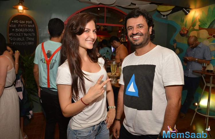 Elli Avram And Vikas Bahl Smiling Pose At Fatty Bow Restaurant Launch