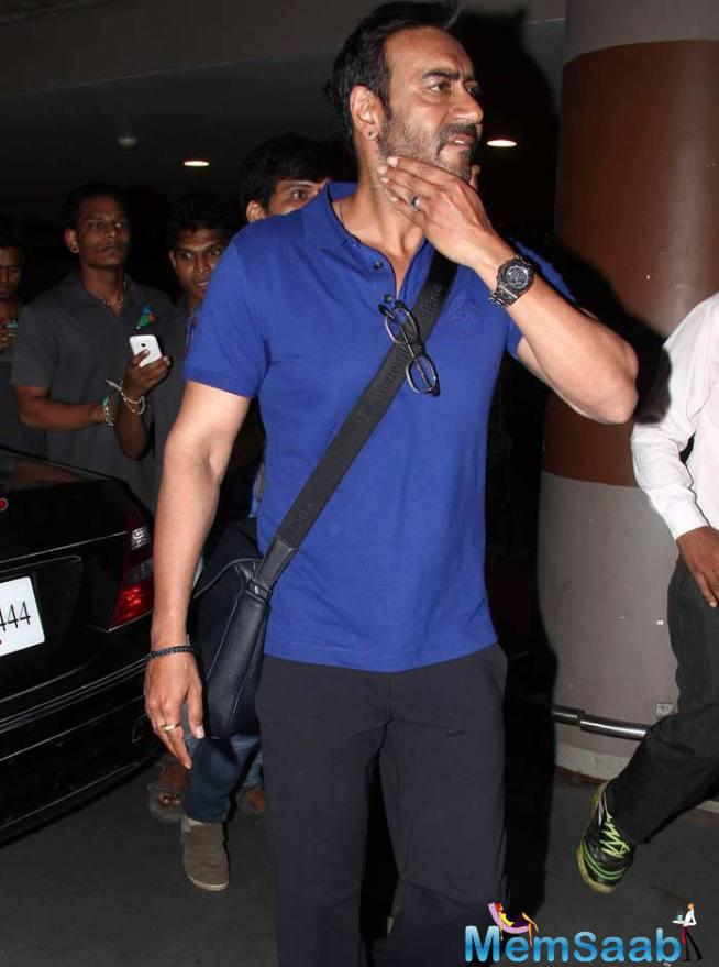Ajay Devgn Was Dressed For Comfort In A Blue Tee Shirt And Black Pants.