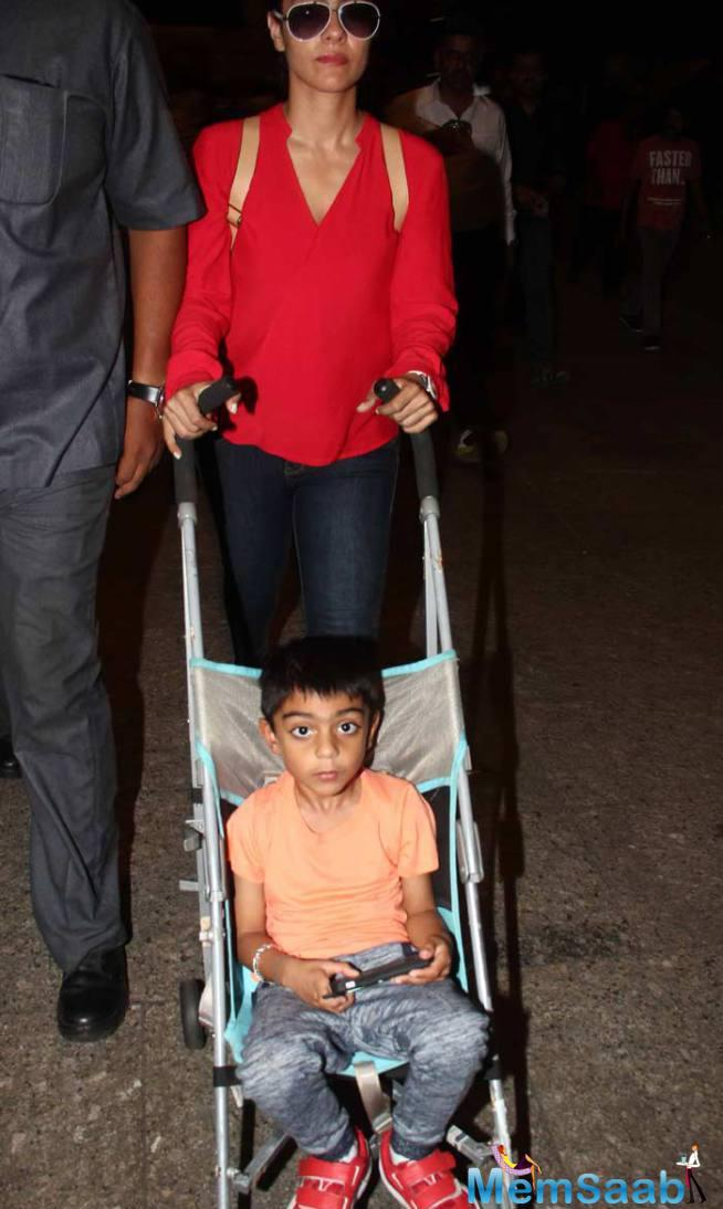 Hands-On-Mom As She Pushed A Strolley With Son Yug