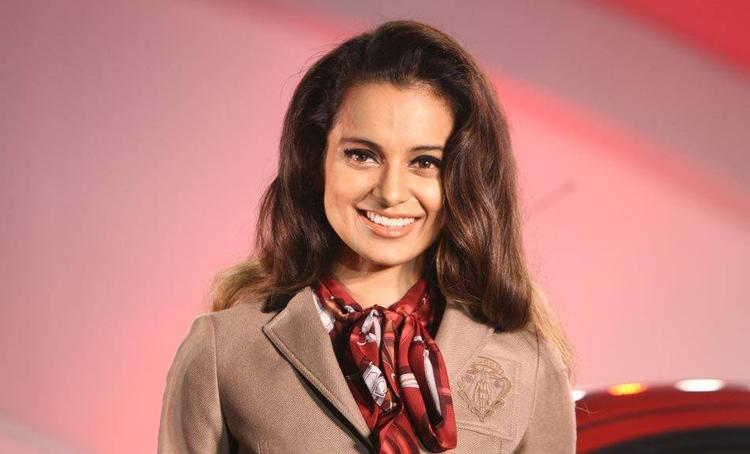Kangana Ranaut Smiling Look During The Launch Of Nissan Micra X-Shift Car