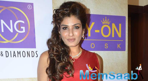 Raveena Tandon Cool Smiling Pose At The Re-Launch Of PN Gadgil Website