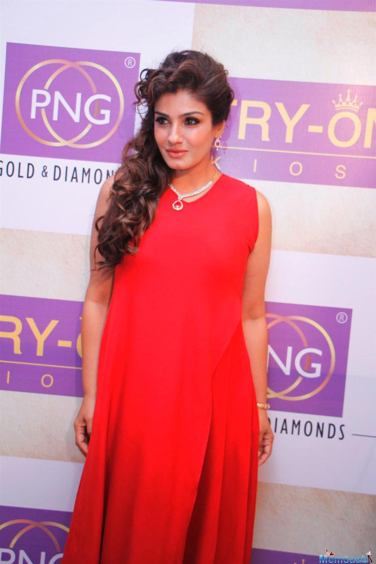 Raveena Tandon In Red Dress Sizzling Look During The Launch Of PN Gadgil Website