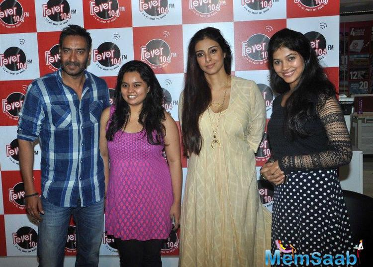 Ajay Devgan And Tabu Posed With Fans Promoted Film Drishyam At Radio Fever 104 FM Studio