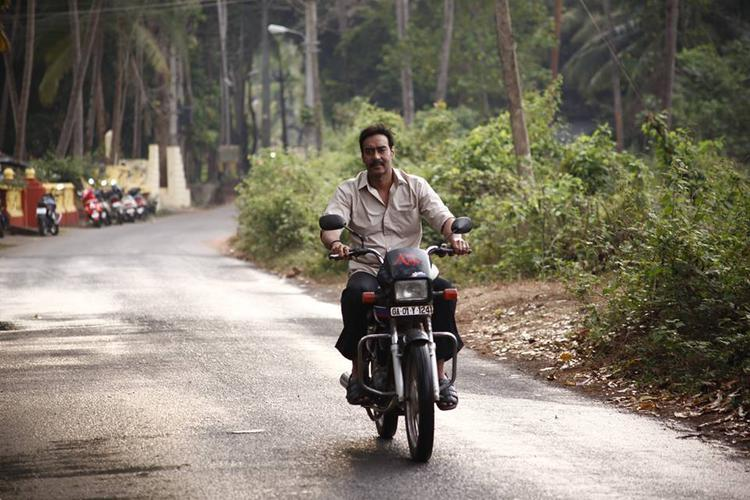 Ajay Devgan In Bike Ride Still From Drishyam Movie