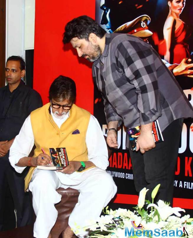 Amitabh Bachchan Autographs One Of The Copies At The Launch