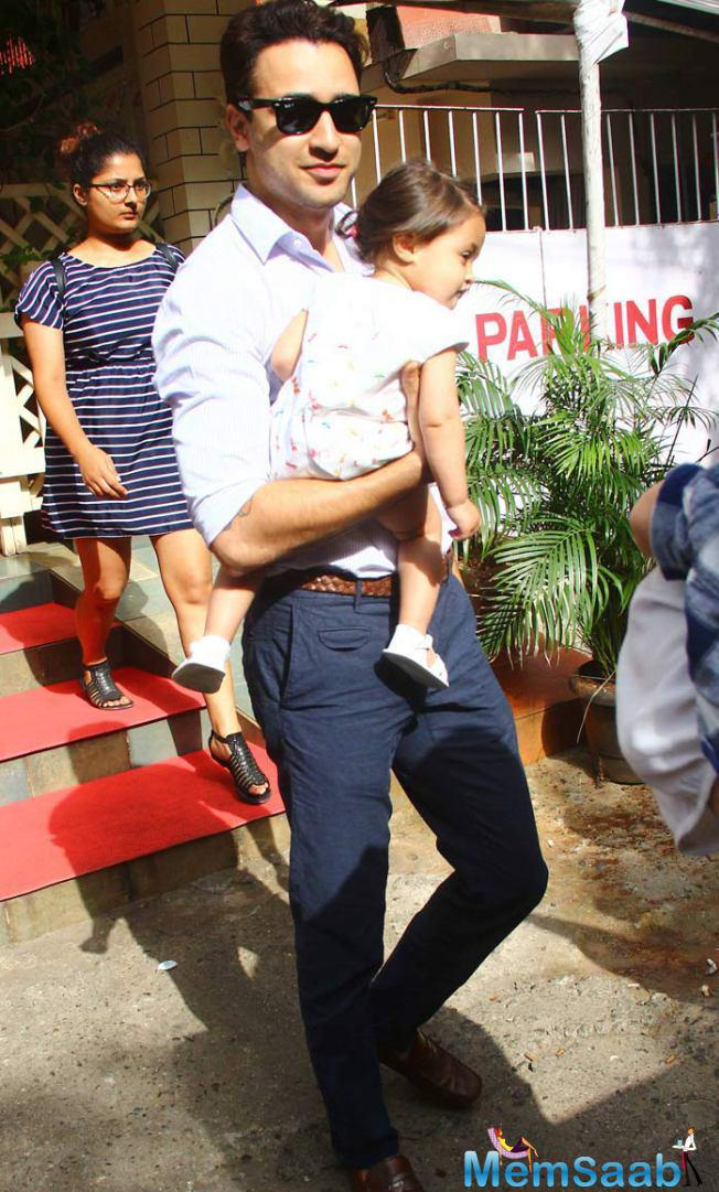 Imran Walked With Ease As He Carried The Tiny Tot In His Arms