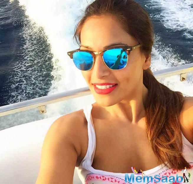 Bipasha's Mirrored Sunnies As She Enjoys A Boat Ride