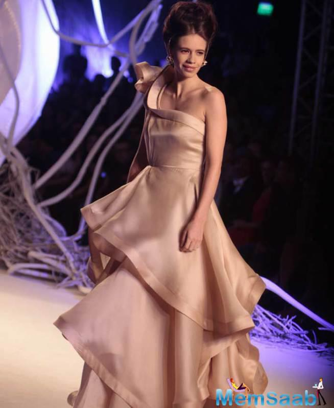 Kalki Was Dressed In A Champagne Coloured One-Shoulder Gown Featuring Dramatic Ruffles