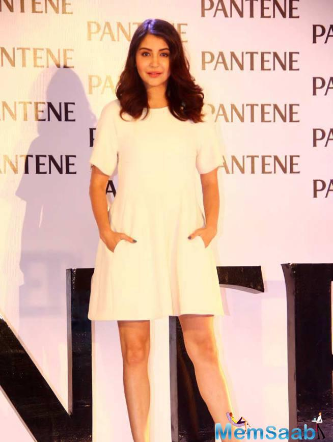 Anushka Sharma Was Beautiful In A White Dior Dress With Black Ankle-Strapped Louboutins.