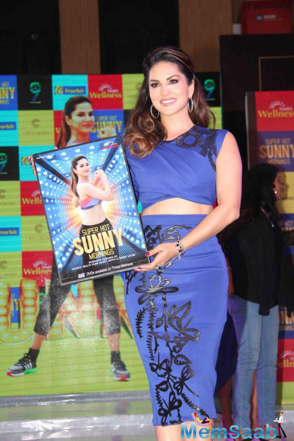 Bollywood Actress Sunny Leone Showcasing Her Fitness DVD Super Hot Sunny Mornings