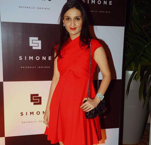 Anu Dewan In Red Dress Sexy Look During Simone Khan Arora Store Anniversary
