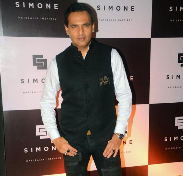 Marc Robinson Strikes A Pose During Simone Khan Arora Store Anniversary