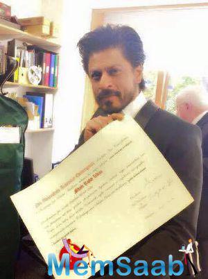 Shah Rukh Khan Holding His Doctorate Degree From The University Of Edinburg