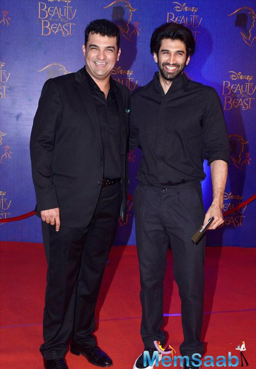 Siddharth Roy Kapur And Aditya Roy Kapur Smiling Pose During The Disney Beauty And The Beast Red Carpet