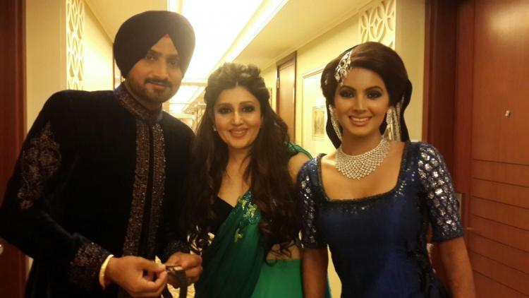 The Newly Wed Couple Is Seen Posing With Their Designer Archana Kochhar