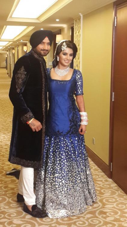 Sizzling Couple Strikes A Pose During Their Reception Party
