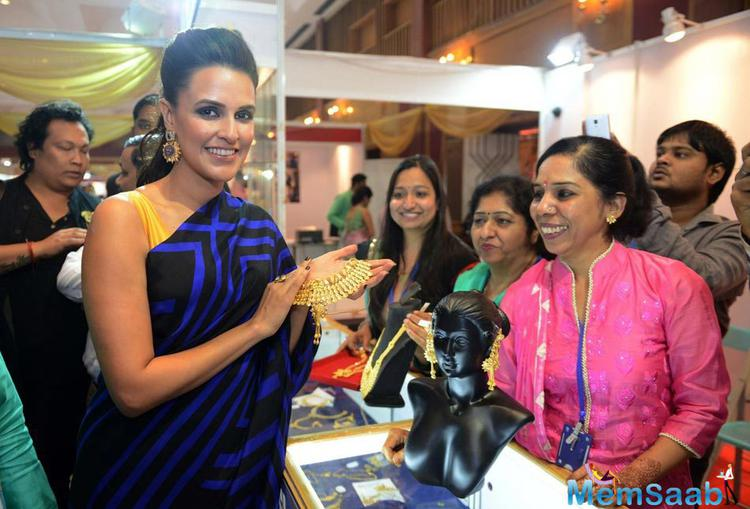 Neha Dhupia Looked Stunning In A Blue Saree At MMTC Gold Exhibition In New Delhi