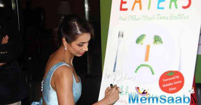 Malaika Arora Khan Autographing On The Book Poster