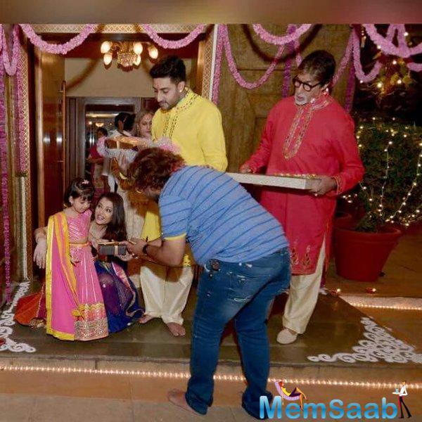 Aaradhya Is Seen Accepting Diwali Gift While Aishwarya, Abhishek And Amitabh Look On