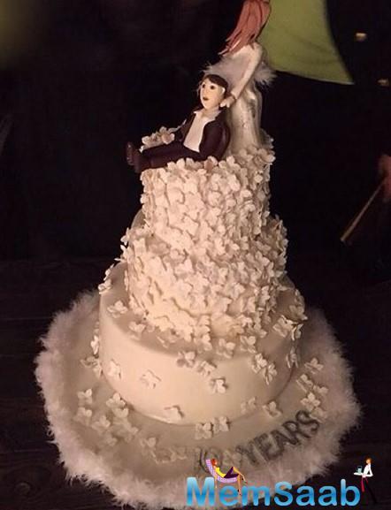 A Beautiful Photograph Of His Wedding Anniversary Cake