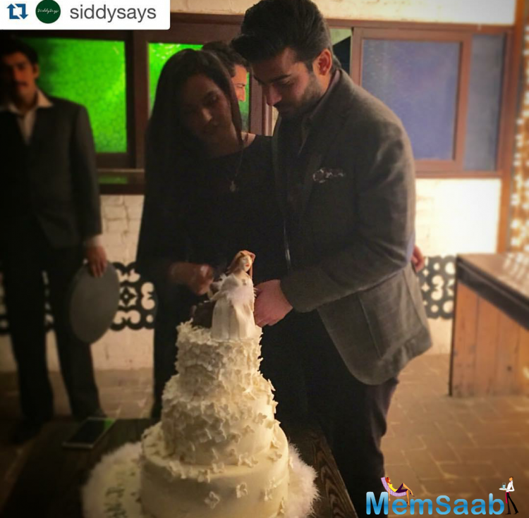 Fawad And His Wife Is Seen Cutting A Cute Wedding Cake