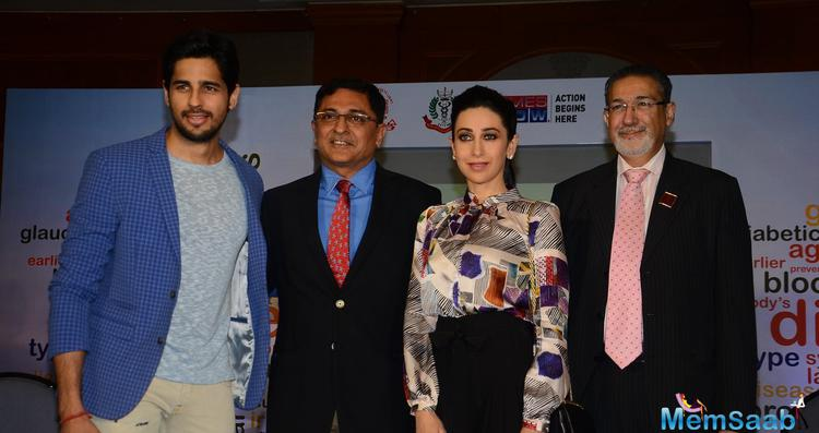 Sidharth Malhotra And Karisma Kapoor Clicked At An Event